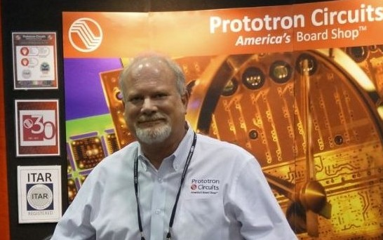 Russ Adams at SMTAI booth.JPG